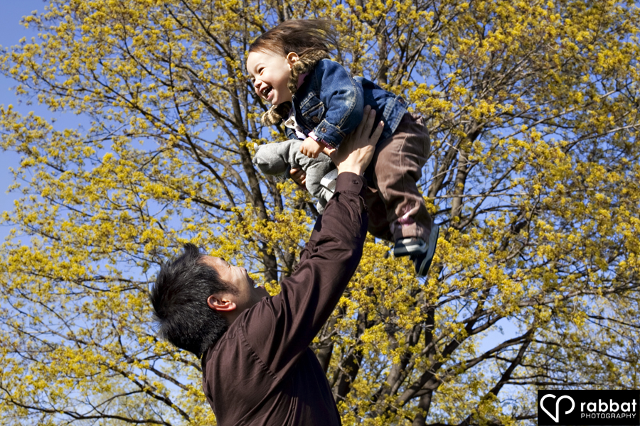 Father and toddler having fun together in the park