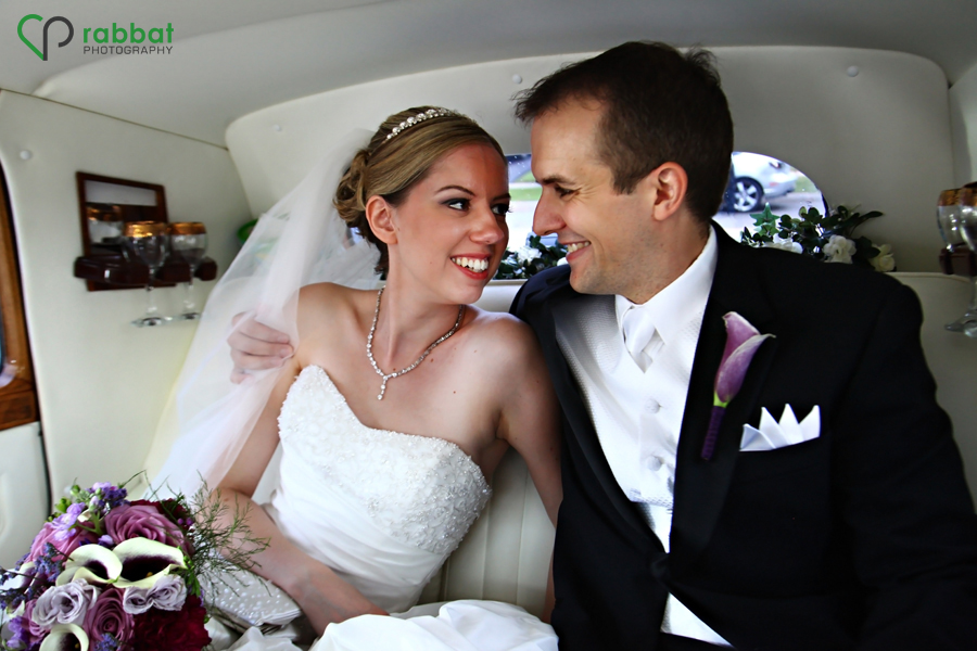 Bride and groom in the limo