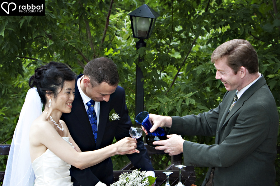 Bride and groom engaging in Japanese wine ritual