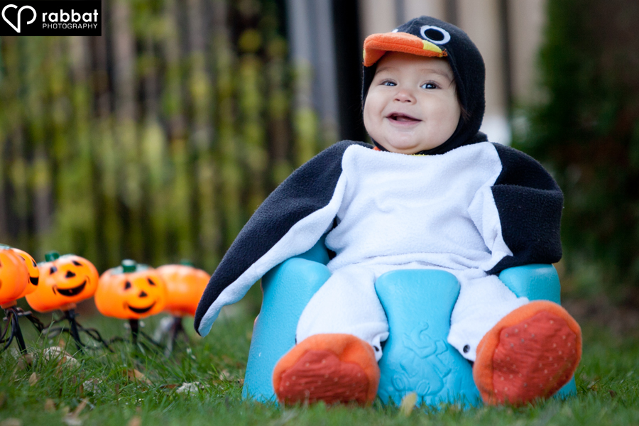 Baby in a penguin costume for Halloween