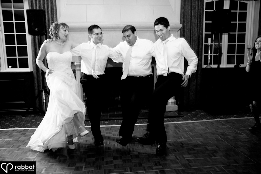 Julia dancing with the groomsmen