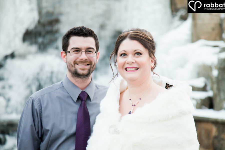 Bride with brother on wedding day at Ancaster Old Mill in winter