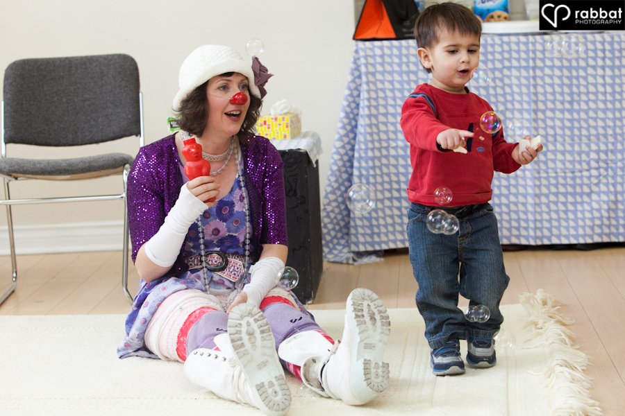 Clown with toddler and bubbles