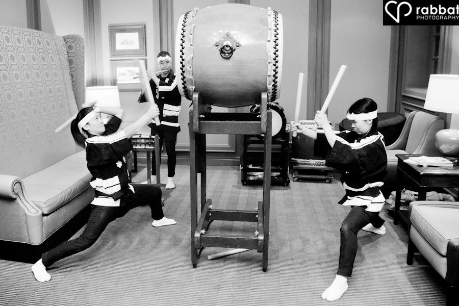 Taiko drummers play during cocktail hour at an Ancaster Old Mill wedding