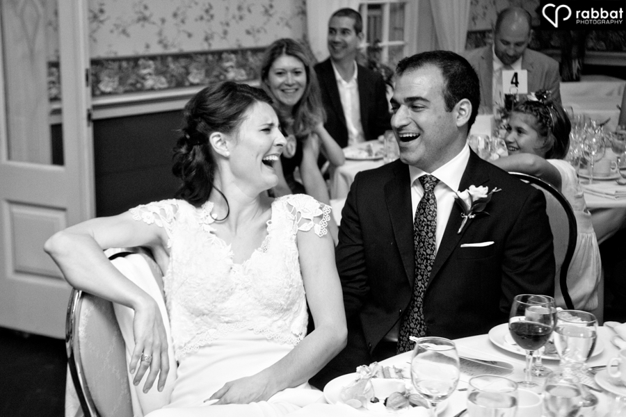 Bride and groom laughing at the reception