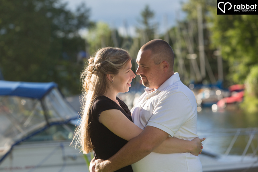 Engagement session surrounded by boats