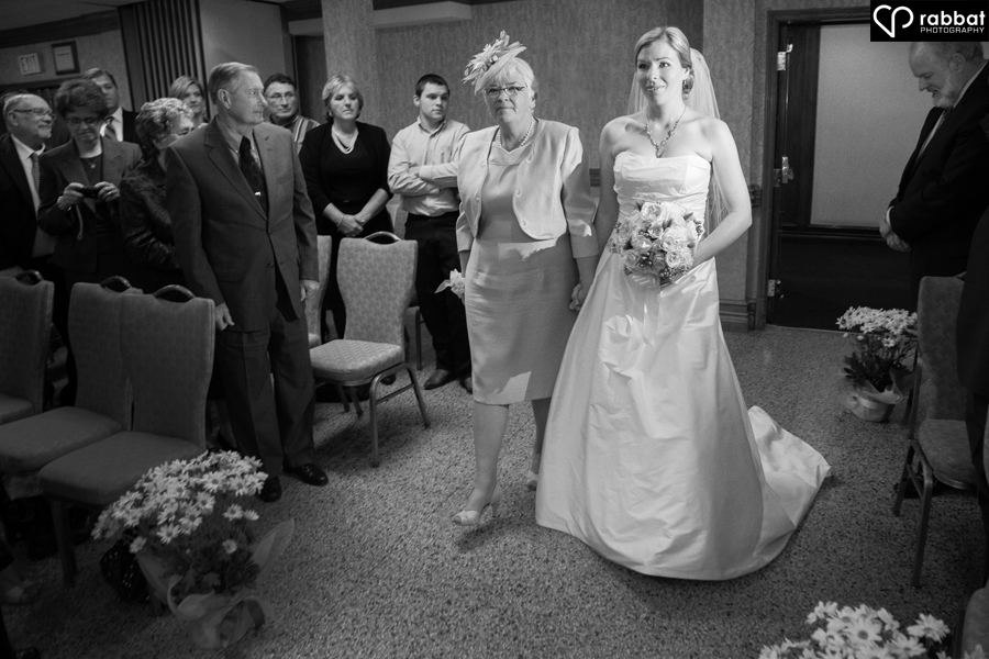 Mom walking her daughter down the aisle