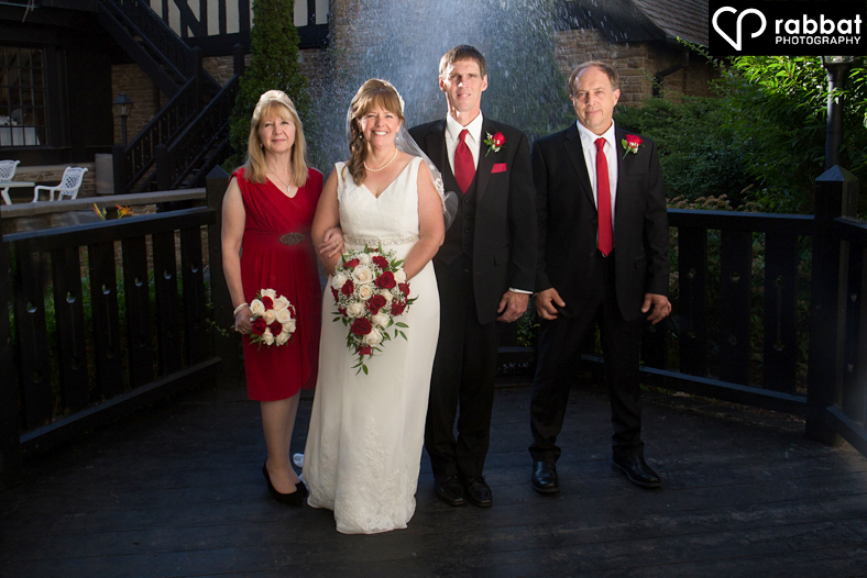 Wedding party in front of fountain at The Old Mill