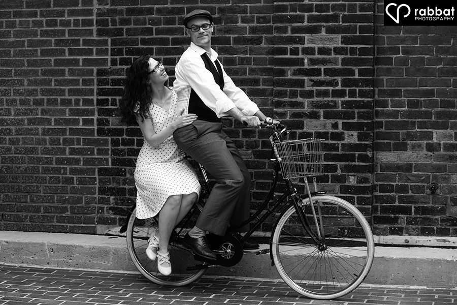 Couple on a bicycle built for two