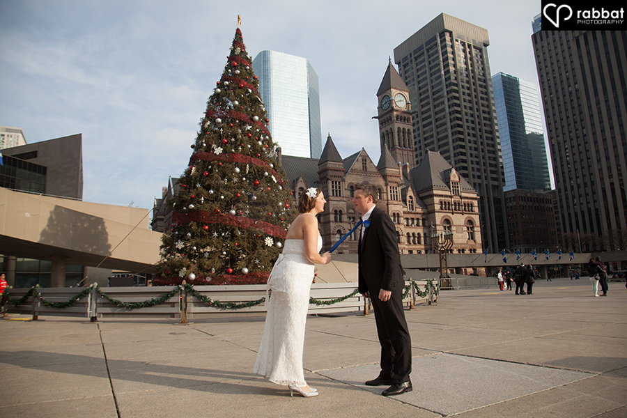 Rockwell inspired Christmas wedding photo of bride and groom at Toronto City Hall