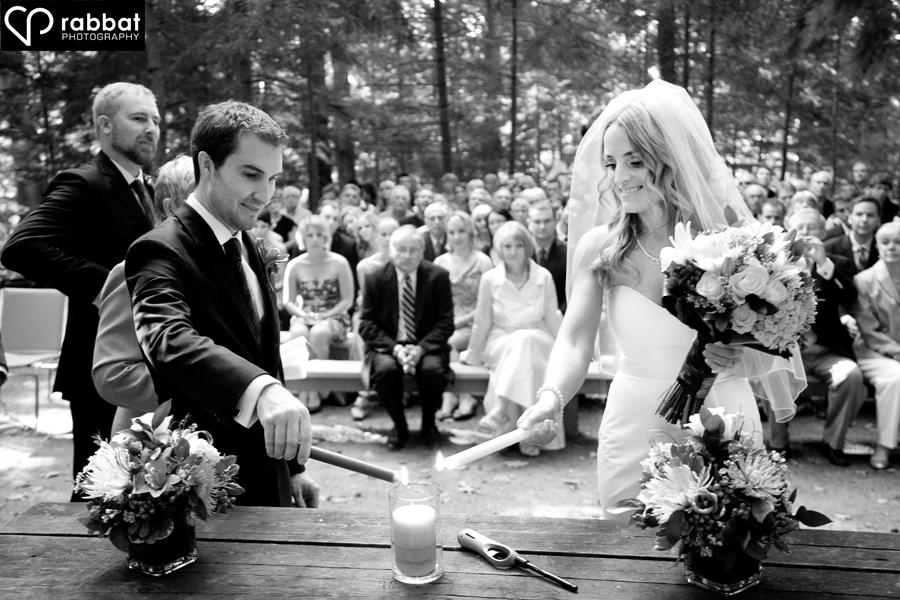 Bride And Groom Lighting The Unity Candle