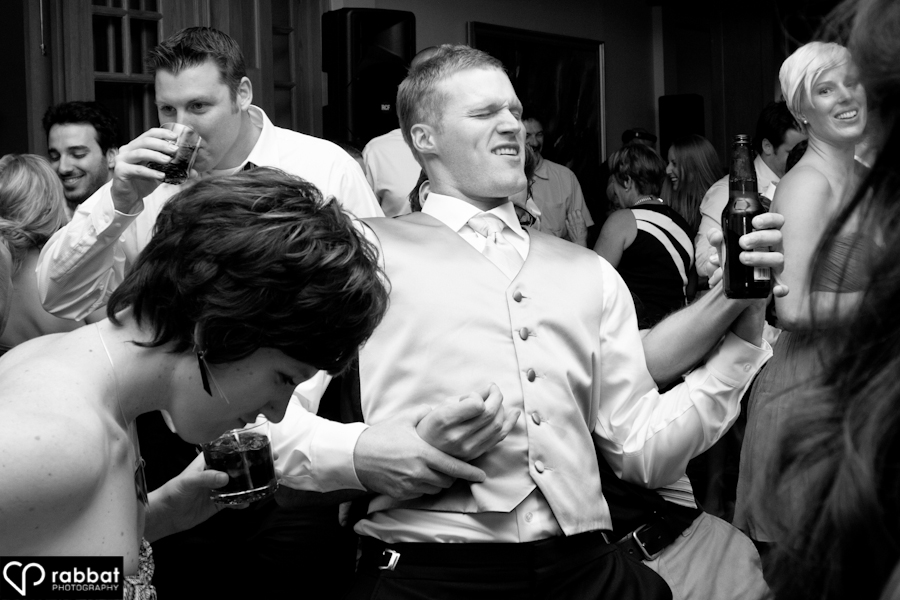 Groom playing air guitar | King valley golf course wedding
