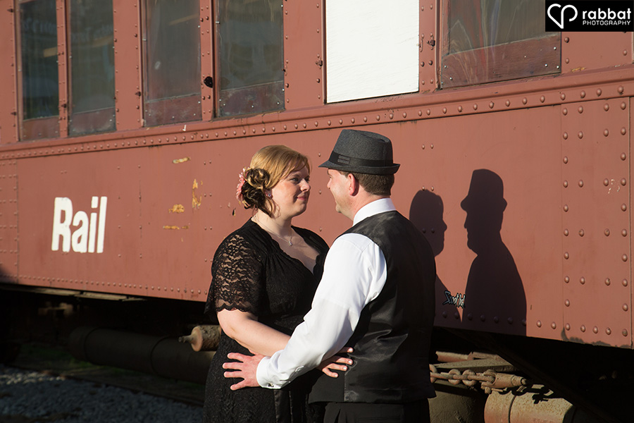Engagement photos in front of a CN train