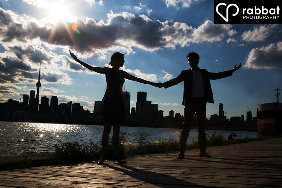 Couples silhouette in front of the Toronto Skyline