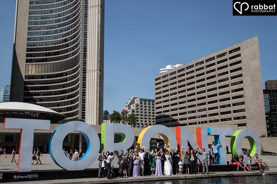 Bridal party in front of iconic Toronto sign at Nathan Phillip's Square