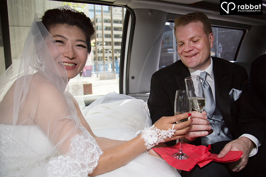 Bride and groom in limo