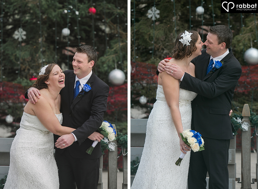 Happy bride and groom in front of Christmas tree