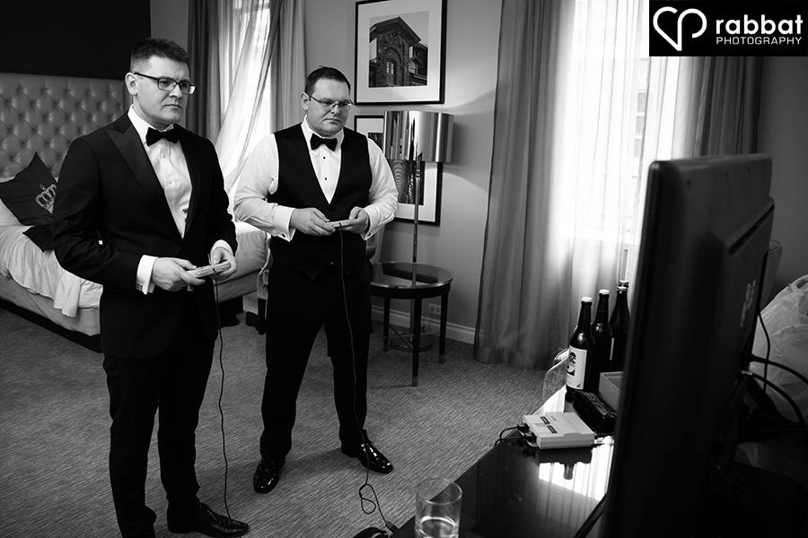 Groom and best man playing video games