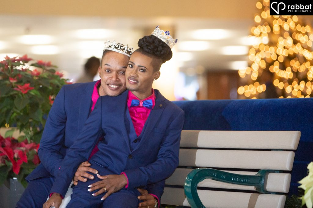 Grooms on a bench at City Hall